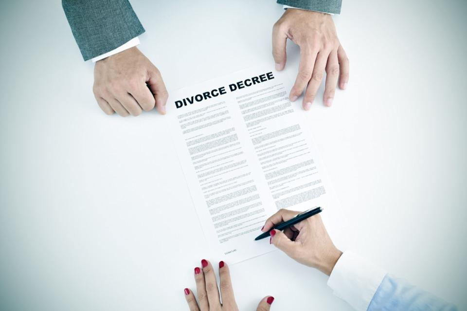 couple signing divorce papers, empty nest