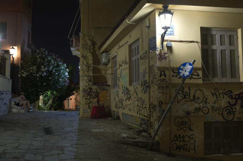 In this Monday, July 22, 2019 photo, a house is covered with graffiti in Athens' Plaka district. Municipal authorities have repeatedly voiced determination to address the problem, with poor results so far. Anti-vandalism laws are rarely enforced and arresting perpetrators doesn't sit high among police priorities. (AP Photo/Petros Giannakouris)