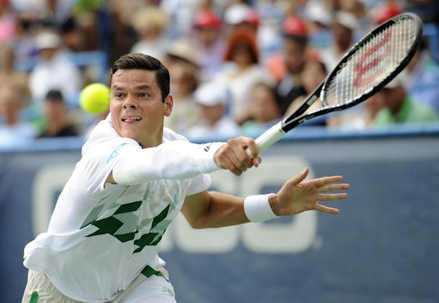 Milos Raonic, of Canada, reaches for the ball against compatriot Vasek Pospisil during the men's singles final at the Citi Open tennis tournament, Sunday, Aug. 3, 2014, in Washington. Raonic won 6-1, 6-4. (AP Photo/Nick Wass)