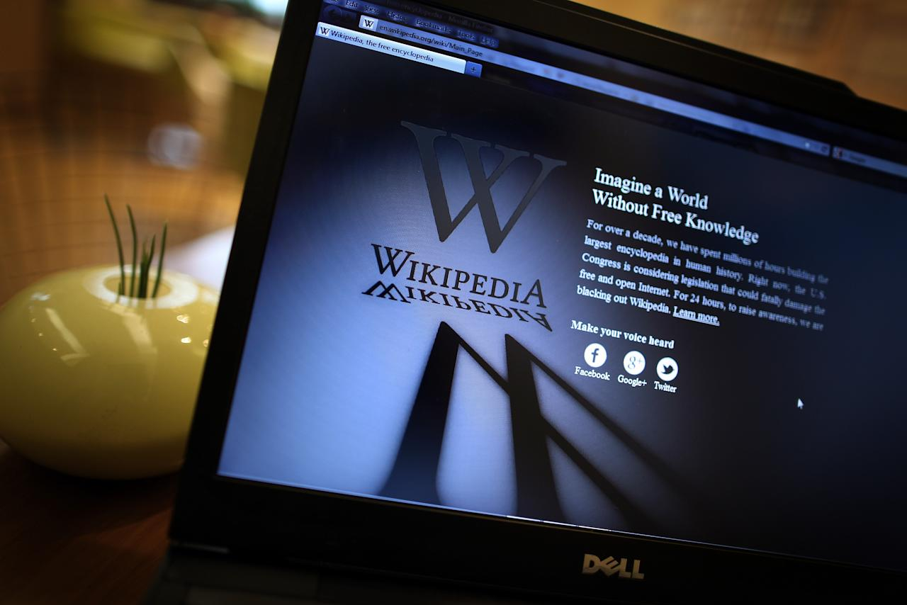 LONDON, ENGLAND - JANUARY 18:  A laptop computer displays Wikipedia's front page showing a darkened logo on January 18, 2012 in London, England. The Wikipedia website has shut down it's English language service for 24 hours in protest over the US anti-piracy laws.  (Photo by Peter Macdiarmid/Getty Images)