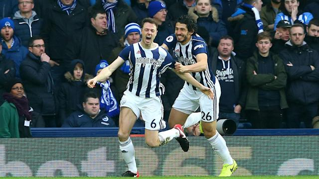 Jonny Evans and Craig Dawson headed home from a pair of corners as West Brom beat Brighton 2-0, their first win in 21 league games.