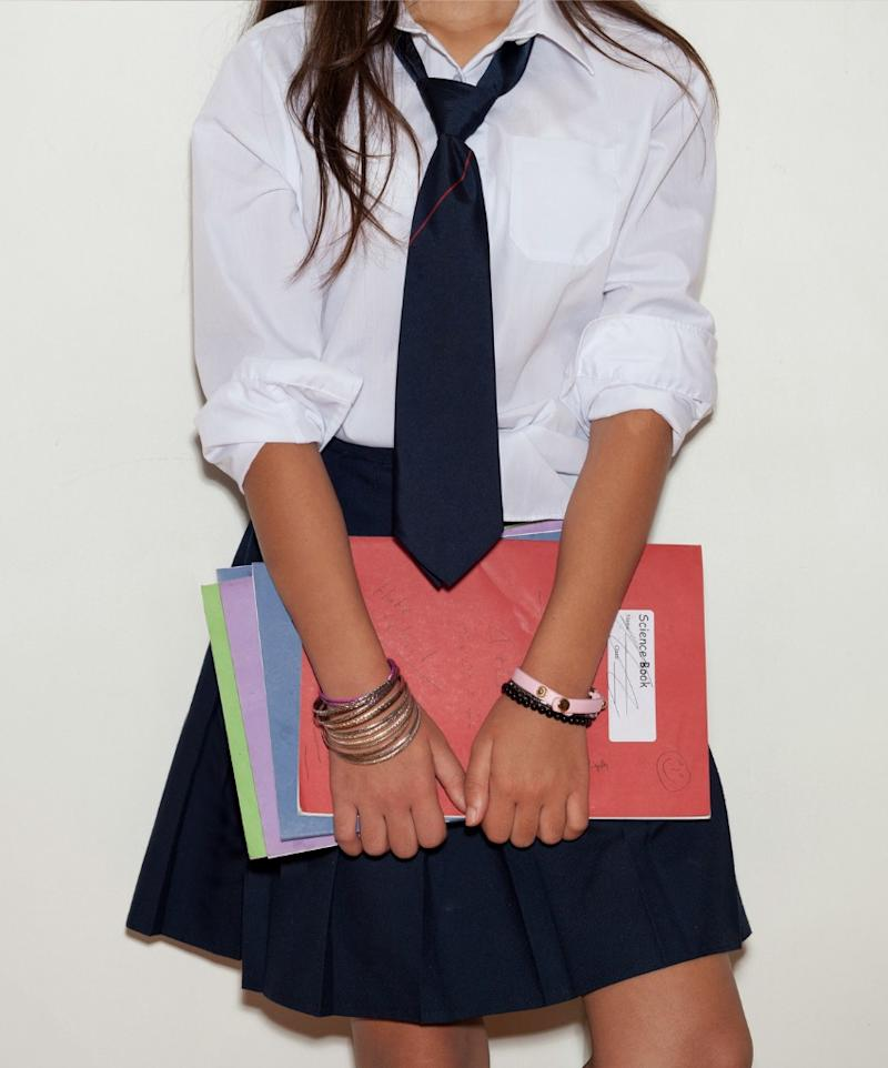 Schoolgirl's skirt hits about two inches above the knee