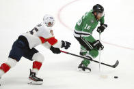 Florida Panthers center Noel Acciari (55) tries to keep Dallas Stars center Joe Pavelski (16) from shooting in the second period during an NHL hockey game on Sunday, March 28, 2021, in Dallas. (AP Photo/Richard W. Rodriguez)