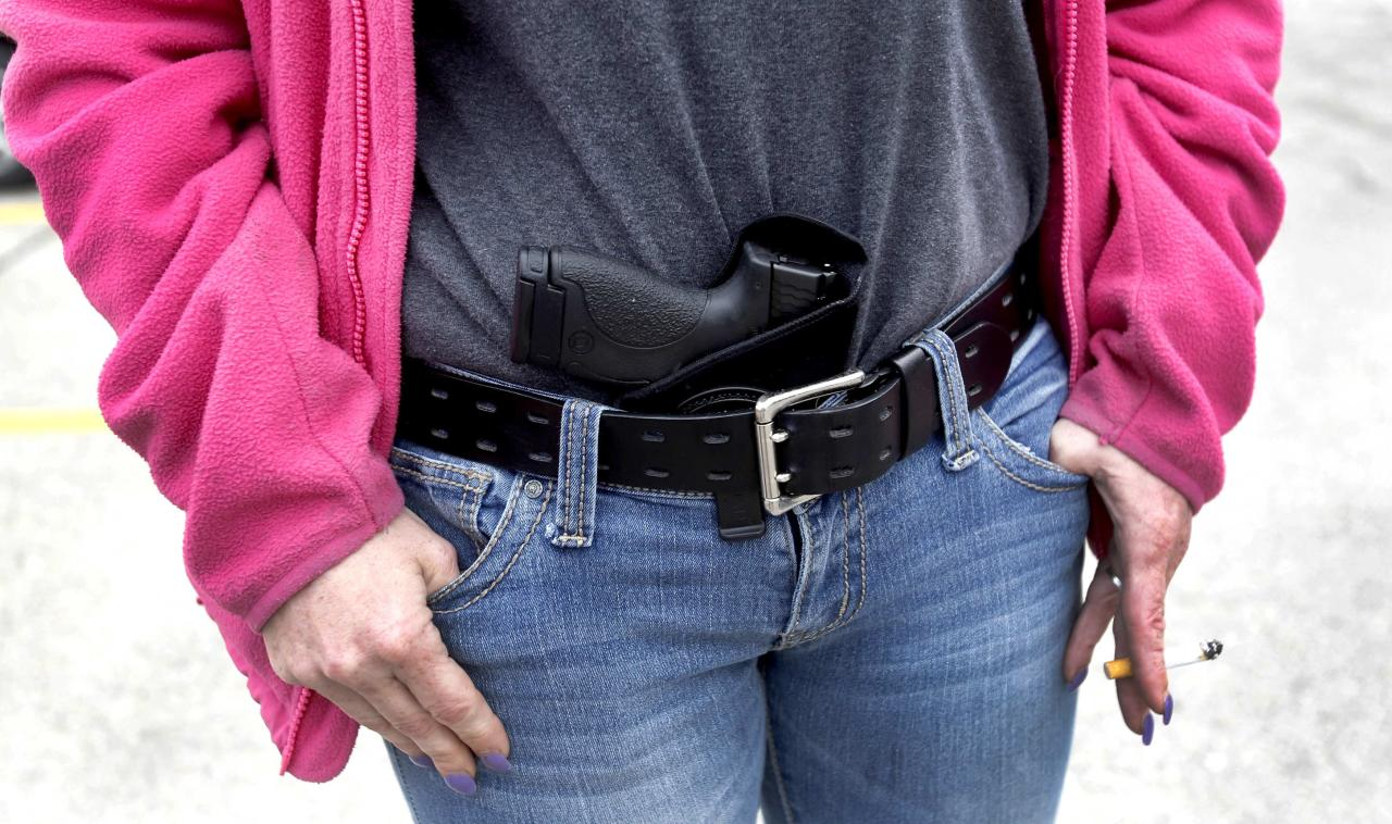 Gloria Lincoln-Thompson carries her 9mm Smith & Wesson pistol in her waist band during a rally in support of the Michigan Open Carry gun law in Romulus, Michigan April 27, 2014. REUTERS/Rebecca Cook (UNITED STATES - Tags: CIVIL UNREST POLITICS SOCIETY)