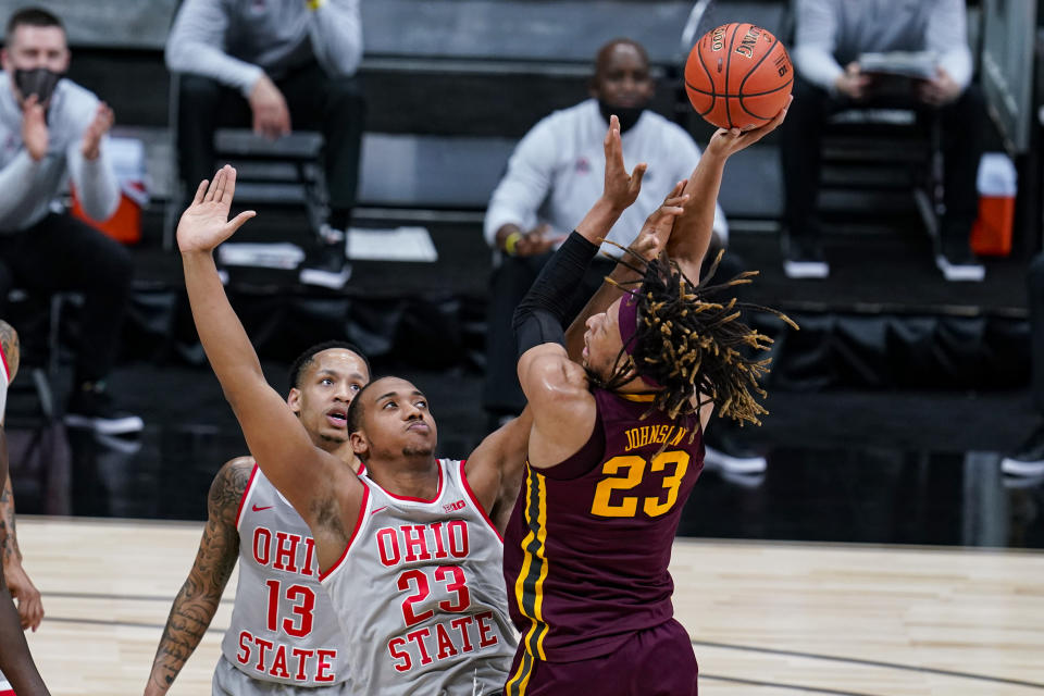 Minnesota forward Brandon Johnson (23) shoots over Ohio State forward Zed Key (23) in the first half of an NCAA college basketball game at the Big Ten Conference tournament in Indianapolis, Thursday, March 11, 2021. (AP Photo/Michael Conroy)