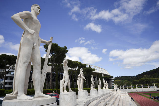 A marble statue holding a fasces, a bundle of rods tied together around an axe, adopted by Italian dictator Benito Mussolini as a symbol of power, adorns the track and field Stadio Dei Marmi stadium of the Foro Italico, in Rome, Monday, May 6, 2019. The Stadio Dei Marmi was designed by architect Enrico Del Debbio and completed in 1928. (AP Photo/Andrew Medichini)
