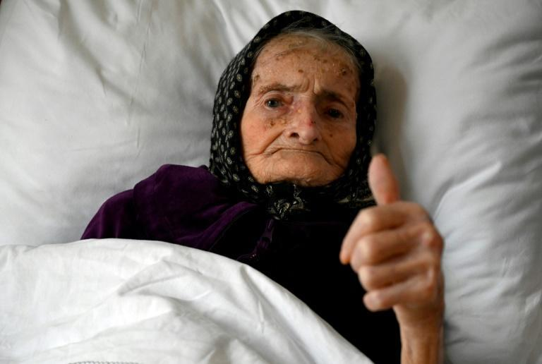 A 99-year-old Croatian woman gives the thumbs up after she successfully beat the coronavirus