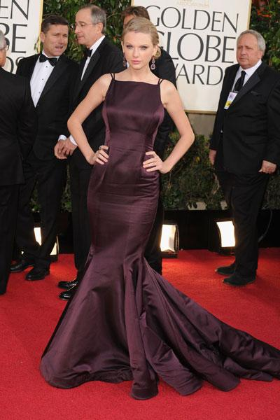 Taylor Swift: Eat your heart out Harry Styles! Taylor Swift, the innocent country girl with curls is gone. In her place is the mature and sexy global star. Wearing a deep plum Donna Karan gown, the Best Original Song nominee looks as if she could have any man she wants with that showstopper. (Photo by Steve Granitz/WireImage)