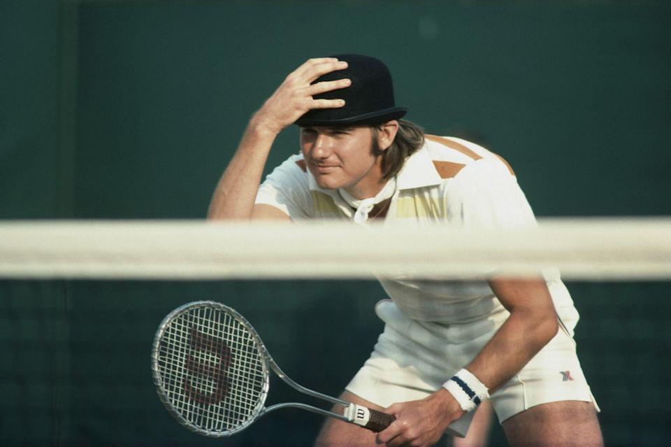 <p>Jimmy Connors jokes with the spectators by wearing a bowler hat during a Men's Doubles match with partner Ilie Nastase on July 1, 1976.</p>