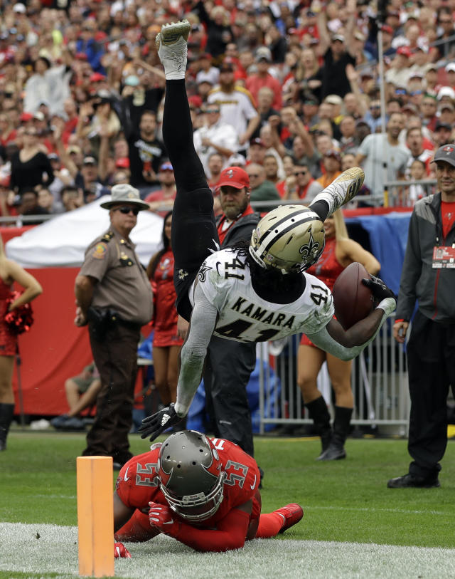 <p>New Orleans Saints running back Alvin Kamara (41) is sent flying on a tackle by Tampa Bay Buccaneers outside linebacker Adarius Taylor (53) during the second half of an NFL football game Sunday, Dec. 9, 2018, in Tampa, Fla. (AP Photo/Mark LoMoglio) </p>