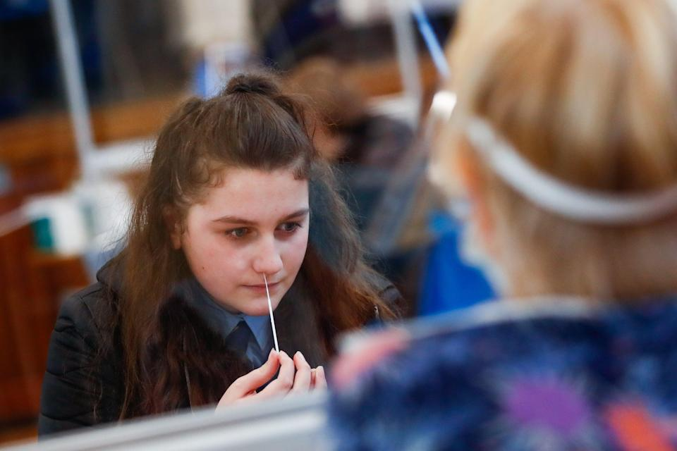 <p>A student takes a lateral flow test at school</p> (Reuters)