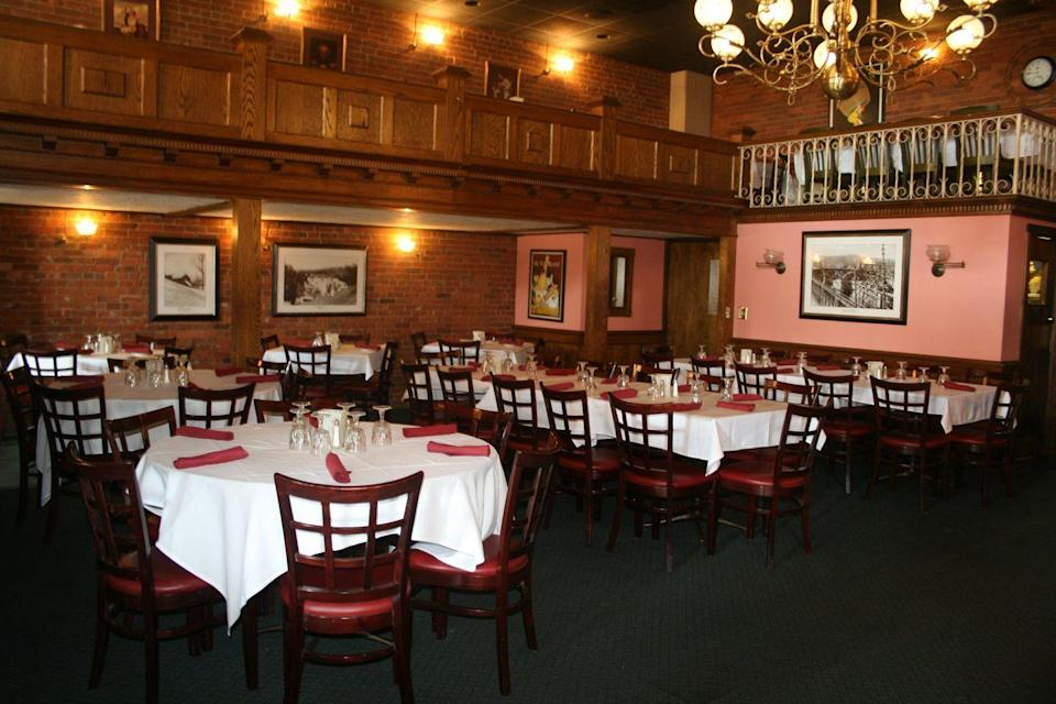 """<p><a href=""""https://www.twistedvinerestaurant.com/"""" rel=""""nofollow noopener"""" target=""""_blank"""" data-ylk=""""slk:The Twisted Vine"""" class=""""link rapid-noclick-resp"""">The Twisted Vine</a> is a building that has been around since the late 1800s. It was once the Birmingham National Bank, and was made into a restaurant in the late 1970s. Employees and guests have seen some pretty weird <a href=""""https://www.nhregister.com/valley/article/Ghost-hunters-find-you-guessed-it-ghosts-13650196.php"""" rel=""""nofollow noopener"""" target=""""_blank"""" data-ylk=""""slk:paranormal"""" class=""""link rapid-noclick-resp"""">paranormal</a> activity, like lights flashing on and off and furniture moving on its own. They even have a weekly paranormal tour, so they're embracing the spiritual vibes.<br></p><p>Photo Credit; Facebook/<a href=""""https://www.facebook.com/109116455790777/photos/a.846486952053720/2306989302670137/?type=3&theater"""" rel=""""nofollow noopener"""" target=""""_blank"""" data-ylk=""""slk:The Twisted Vine"""" class=""""link rapid-noclick-resp"""">The Twisted Vine</a></p>"""