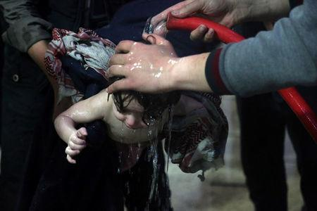 A child is treated in a hospital in Douma, eastern Ghouta in Syria, after what a Syria medical relief group claims was a chemical attack (White Helmets/Handout via Reuters)