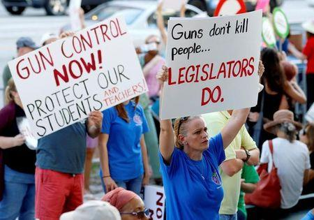 Stefanie Hartman of Coconut Creek Florida holds a sign during the March for Action on Gun Violence in Broward County in Fort Lauderdale