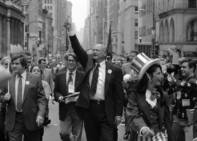 In this Sept. 7, 1981 file photo, New York City Mayor Ed Koch, center,  gestures as he marches in a Labor Day parade down New York's Fifth Avenue. Koch died Friday, Feb. 1, 2013 from congestive heart failure, spokesman George Arzt said. He was 88. (AP Photo/Perez, file)