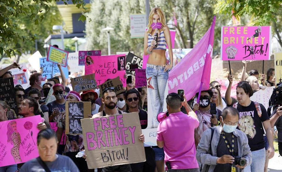 Britney Spears supporters march outside a the court house in Los Angeles during a hearing concerning the pop singer's conservatorship.