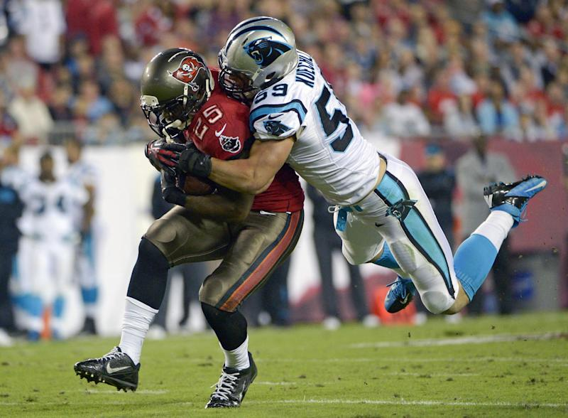 Tampa Bay Buccaneers running back Mike James (25) catches a pass for a first down as he is tacked by Carolina Panthers middle linebacker Luke Kuechly (59) during the first half of an NFL football game in Tampa, Fla., Thursday, Oct. 24, 2013. (AP Photo/Phelan M. Ebenhack)