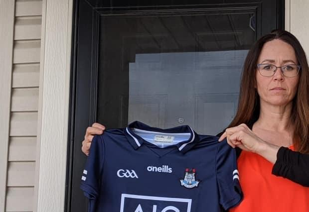 Michelle Sinclair says she found out the hard way that 'import duty/tax and clearance fees' owed on an imported Irish football jersey were mostly processing fees that went to DHL. (Colin Hall/CBC - image credit)