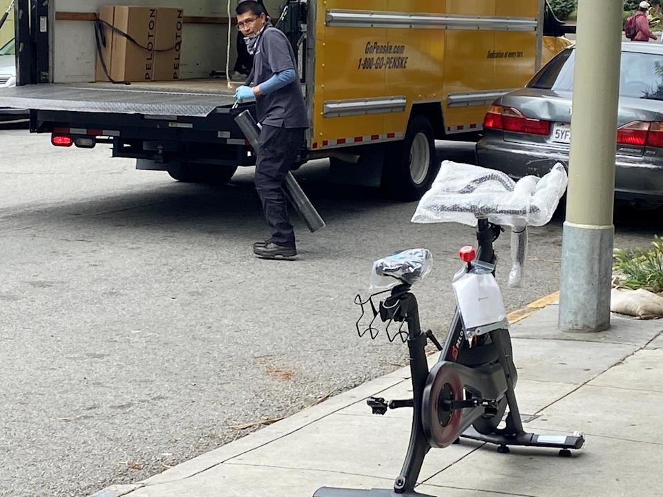 A Peloton indoor exercise bicycle is delivered to a customer during the coronavirus disease (COVID-19) lockdown in San Francisco, California, U.S. April 9, 2020. REUTERS/Greg Mitchell