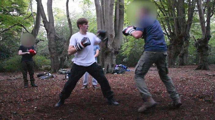Benjamin Hannam, pictured here boxing outdoors, is the first police officer to be convicted of belonging to a banned neo-Nazi terror groupPA
