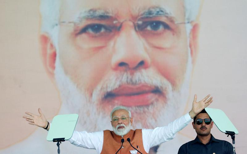 India's Prime Minister Narendra Modi gestures as he addresses an election campaign rally in Meerut - REUTERS