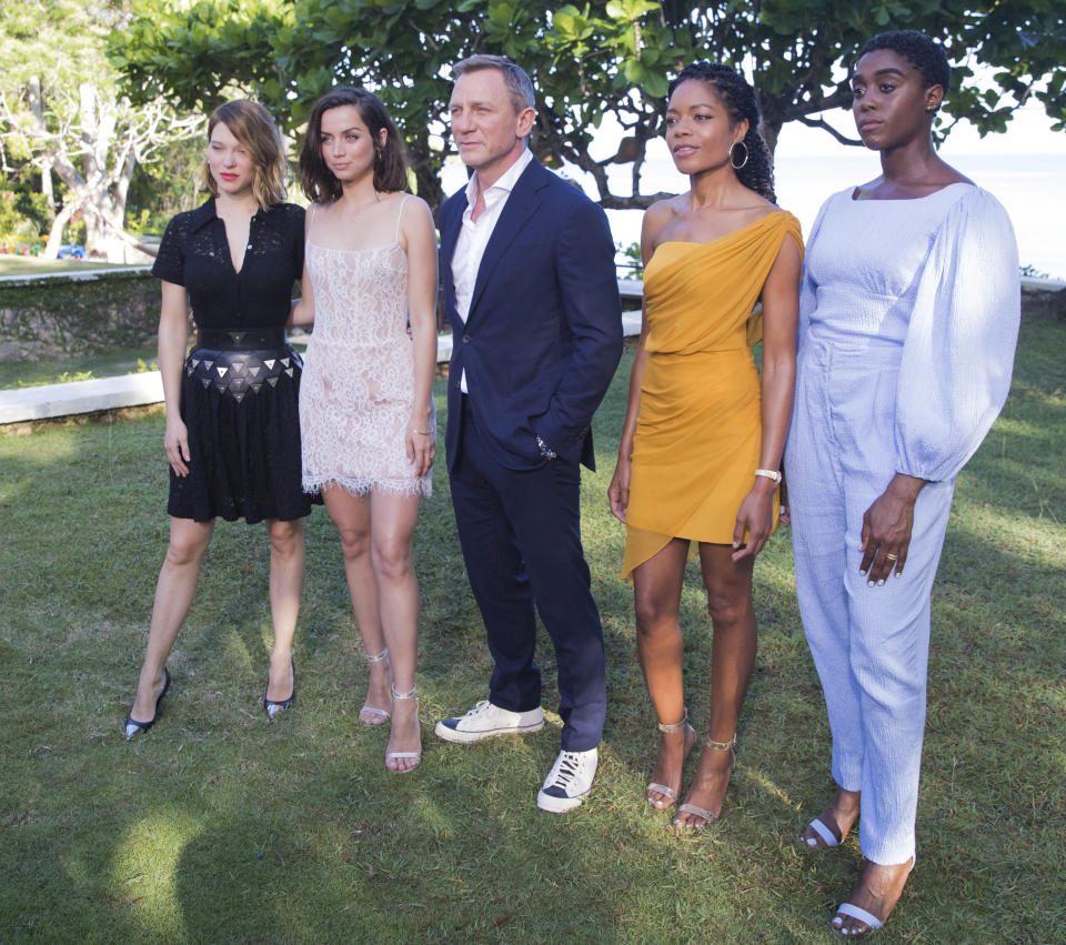 Actors Lea Seydoux, from left, Ana de Armas, Daniel Craig, Naomie Harris and Lashana Lynch pose for photographers during the photo call of the latest installment of the James Bond film franchise, currently known as 'Bond 25', in Oracabessa, Jamaica, Thursday, April 25, 2019. (AP Photo/Leo Hudson)