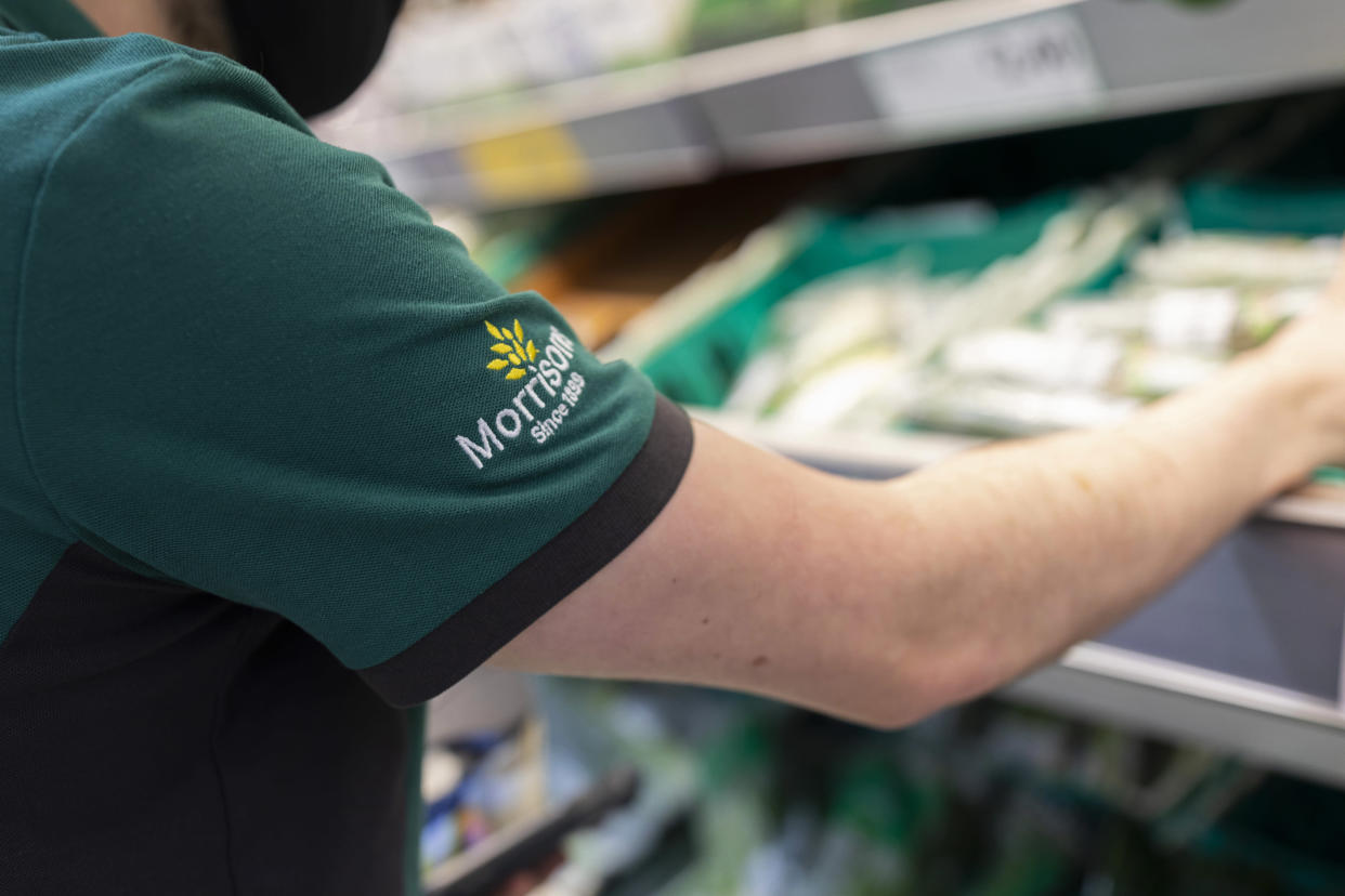 A uniformed member of staff sorts through fresh produce in British supermarket chain Morrisons on 23rd August, 2021 in Leeds, United Kingdom. British supermarket chain Morrisons, which employs over 110,000 staff across its 500 shops, has accepted a £6.3bn ($8.7bn) takeover bid from US private equity firm Fortress Investment Group. (photo by Daniel Harvey Gonzalez/In Pictures via Getty Images)