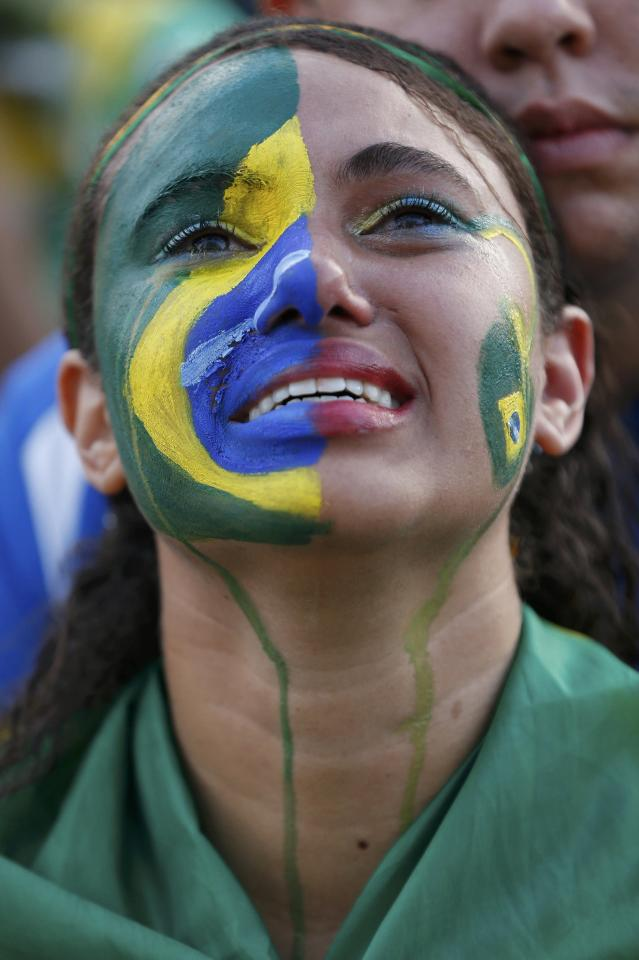 A fan of Brazil reacts while watching a broadcast of the 2014 World Cup semi-final against Germany at the Fan Fest in Brasilia, July 8, 2014. REUTERS/Ueslei Marcelino (BRAZIL - Tags: SOCCER SPORT WORLD CUP)