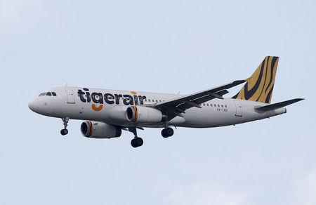 FILE PHOTO -  A Tiger Airways Airbus A320 plane approaches Singapore's Changi Airport