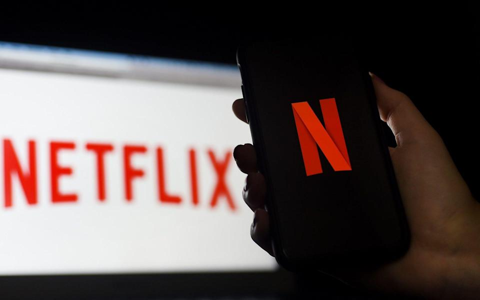 A computer and a mobile phone screen display the Netflix logo - OLIVIER DOULIERY /AFP