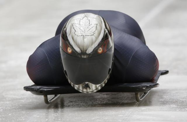 Canada's Eric Neilson speeds down during an unofficial men's skeleton progressive training at the Sanki sliding center in Rosa Khutor, a venue for the Sochi 2014 Winter Olympics near Sochi, February 5, 2014. REUTERS/Murad Sezer (RUSSIA - Tags: SPORT OLYMPICS SKELETON)