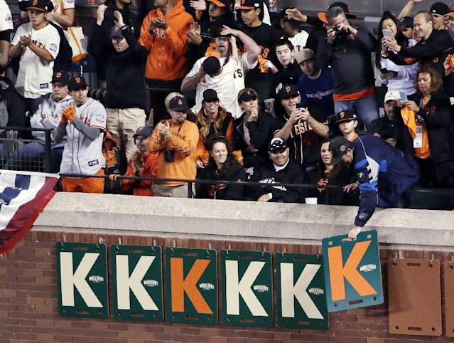 Fans put up a K sign after a strikeout by San Francisco Giants' Madison Bumgarner during the fifth inning of Game 5 of baseball's World Series against the Kansas City Royals on Sunday, Oct. 26, 2014, in San Francisco. (AP Photo/Marcio Jose Sanchez)