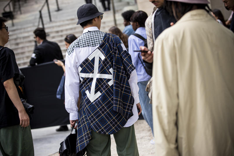 PARIS, FRANCE - JUNE 19: A guest, Off-White fashion details, is seen outside Valentino fashion show on Day 2 during the Paris Fashion Week Spring/Summer 2020 on June 19, 2019 in Paris, France. (Photo by Claudio Lavenia/Getty Images)