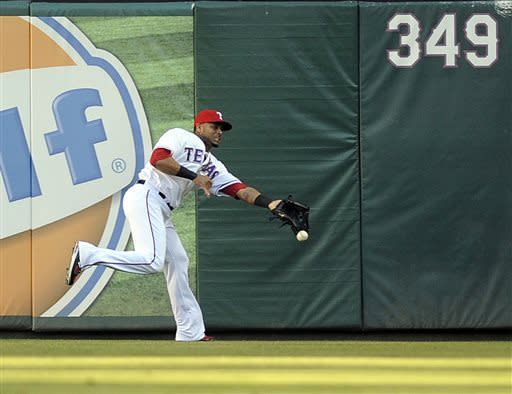 Texas Rangers right fielder Nelson Cruz can't get to a triple by Chicago White Sox's Tyler Greene in the first inning of a baseball game, Tuesday, April 30, 2013, in Arlington, Texas. (AP Photo/Matt Strasen)