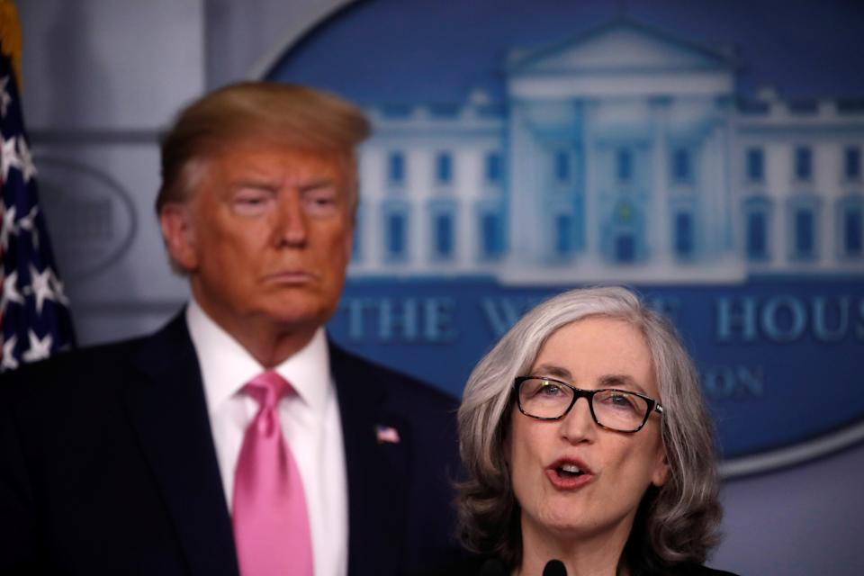 U.S. President Donald Trump listens as Dr. Anne Schuchat, Principal Deputy Director of the Centers for Disease Control and Prevention (CDC) gives a news conference at the White House in Washington, U.S., February 26, 2020.  REUTERS/Carlos Barria