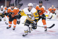 Pittsburgh Penguins' Sidney Crosby, center, heads after the puck after winning the face off against Philadelphia Flyers' Scott Laughton, right, with Michael Raffl, left, following during the third period of an NHL hockey game, Wednesday, Jan. 13, 2021, in Philadelphia. The Flyers won 6-3. (AP Photo/Chris Szagola)