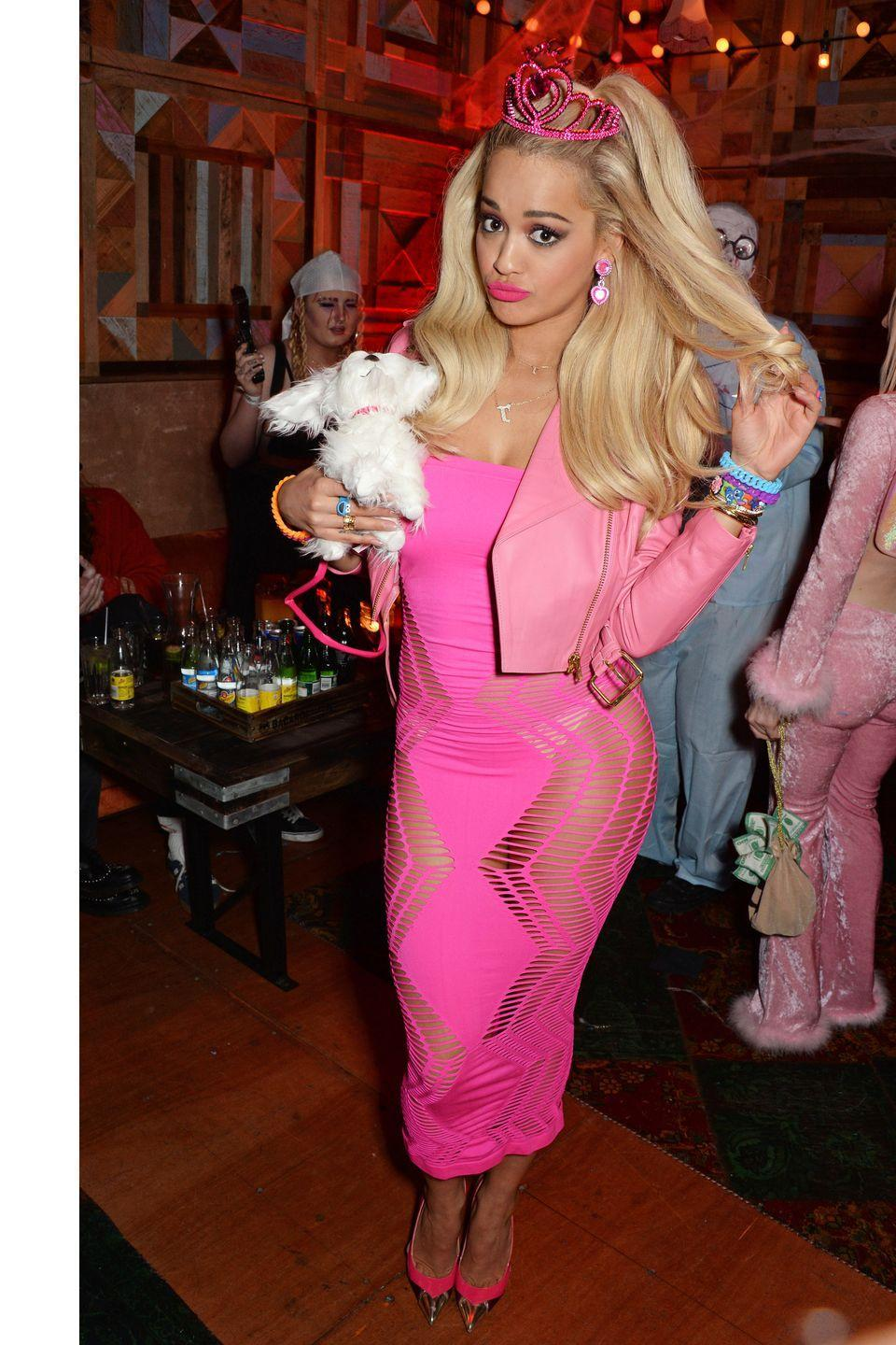 <p>When Rita Ora dressed up as Barbie in 2015, everyone applauded. That's how iconic the doll still is today. Pink, pink, plus more pink is the winning formula for this Halloween costume. Complete the look with a body-con dress and voluminous waves.</p>