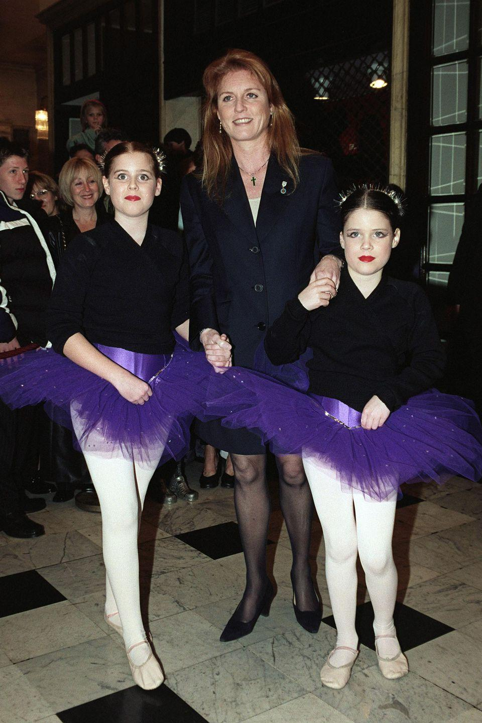 "<p>Princess Beatrice and Princess Eugenie dressed as ballerinas in purple tutus while arriving with their mother, Sarah Ferguson, for ""Santa's Starry Night"" show at the Drury Lane Theatre. </p>"