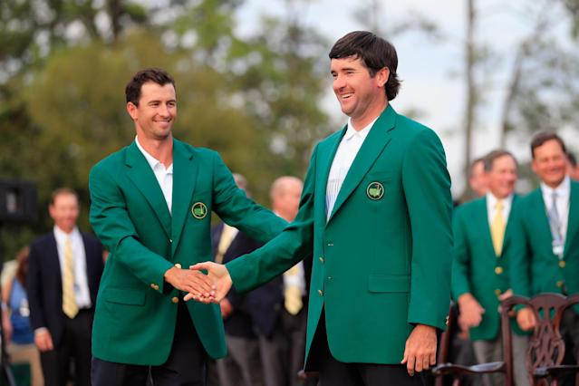 AUGUSTA, GA - APRIL 13: Adam Scott of Australia presents Bubba Watson of the United States with the green jacket after Watson won the 2014 Masters Tournament by a three-stroke margin at Augusta National Golf Club on April 13, 2014 in Augusta, Georgia. (Photo by Rob Carr/Getty Images)