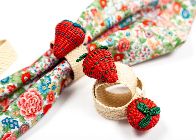 Land of Belle Penelope napkin ($165 for a set of four) and Strawberry napkin rings ($48 for a set of four). landofbelle.com