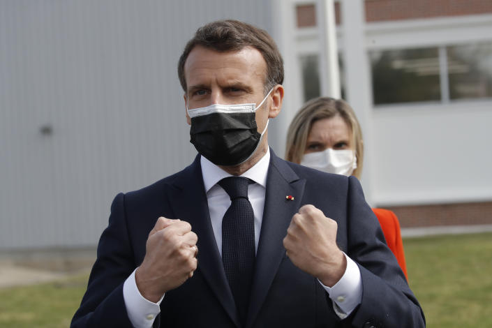 French President Emmanuel Macron reacts after visiting the Delpharm plant in Saint-Remy-sur-Avre, west of Paris, Friday, April 9, 2021 in Paris. The Delpharm plant started bottling Pfizer vaccines this week as France tries to make its mark on global vaccine production, and speed up vaccinations of French people amid a new virus surge. (AP Photo/Christophe Ena, Pool)