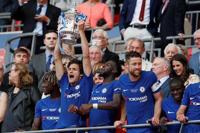 Soccer Football - FA Cup Final - Chelsea vs Manchester United - Wembley Stadium, London, Britain - May 19, 2018 Chelsea's Marcos Alonso lifts the trophy as they celebrate winning the FA Cup REUTERS/David Klein