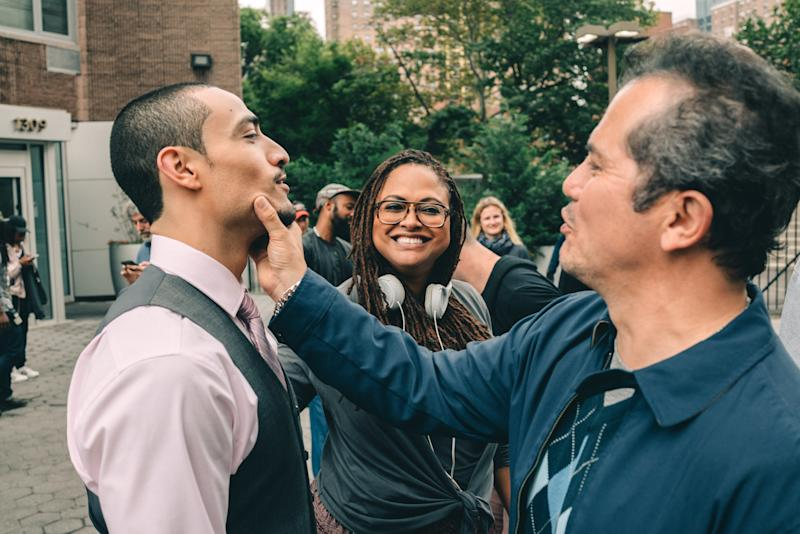 Director Ava DuVernay with Freddy Miyares (left) and John Leguizamo on the set of Netflix's four-part series When They See Us.