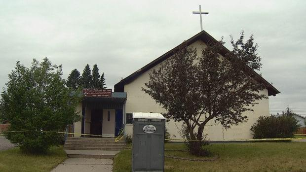 Police said a fire at the House of Prayer Alliance Church caused damage to the exterior, and small fires and smoke damage inside. (Mike Symington/CBC - image credit)
