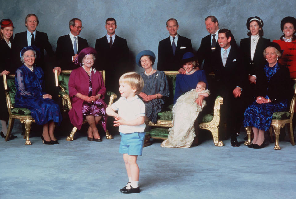 Prince Harry was christened at Windsor Castle on Dec. 21, 1984. In this official photo, he and his mother are surrounded by royal relatives and godparents amused at the antics of young Prince William. (Photo: Getty Images)