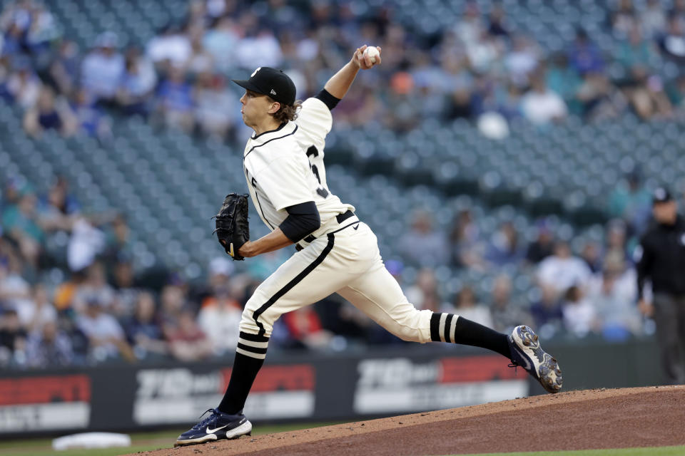 Seattle Mariners starting pitcher Logan Gilbert works against the Tampa Bay Rays during the first inning of a baseball game Saturday, June 19, 2021, in Seattle. (AP Photo/John Froschauer)