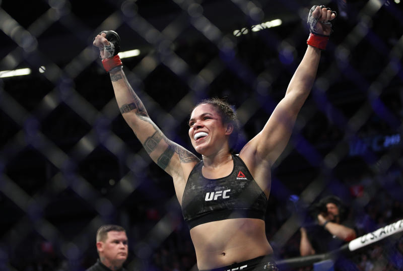 Amanda Nunes celebrates after defeating Germaine de Randamie in a mixed martial arts women's bantamweight championship bout at UFC 245, Saturday, Dec. 14, 2019, in Las Vegas. (AP Photo/John Locher)