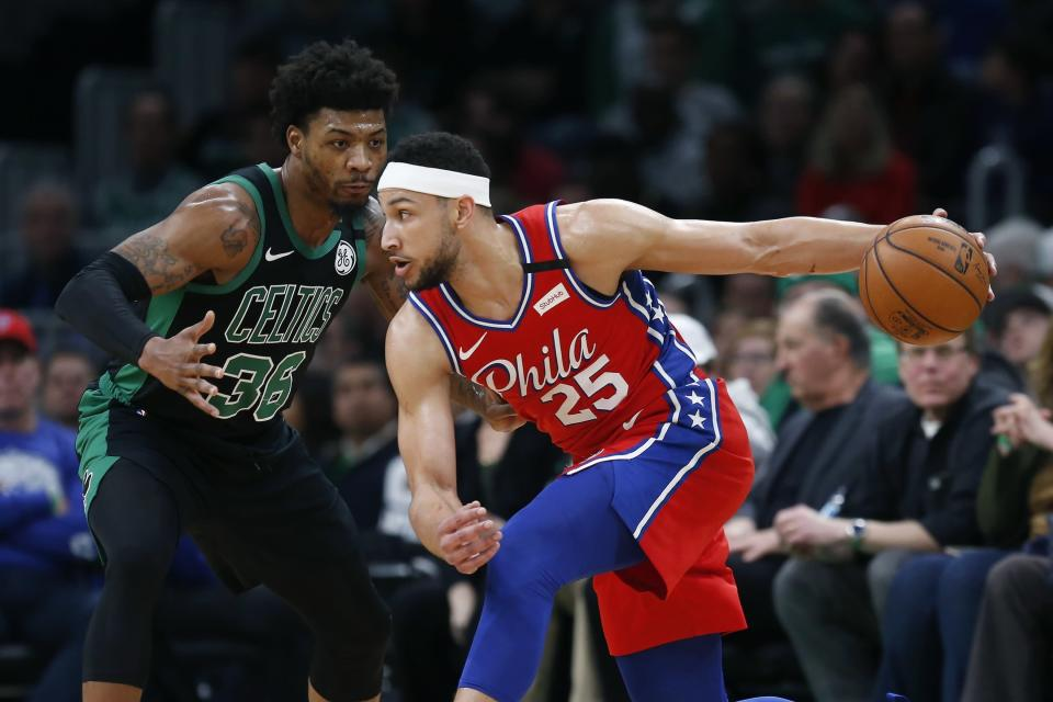 Philadelphia 76ers' Ben Simmons (25) looks to move against Boston Celtics' Marcus Smart (36) during the first half of an NBA basketball game in Boston, Saturday, Feb. 1, 2020. (AP Photo/Michael Dwyer)