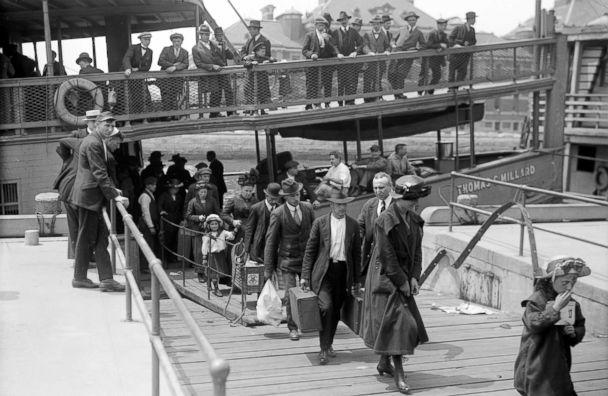 PHOTO: Newly arrived immigrants disembark from the passenger steamer Thomas C. Millard upon their arrival at Ellis Island, in New York, cicra 1905. (Bain News Service/Interim Archives/Getty Images)
