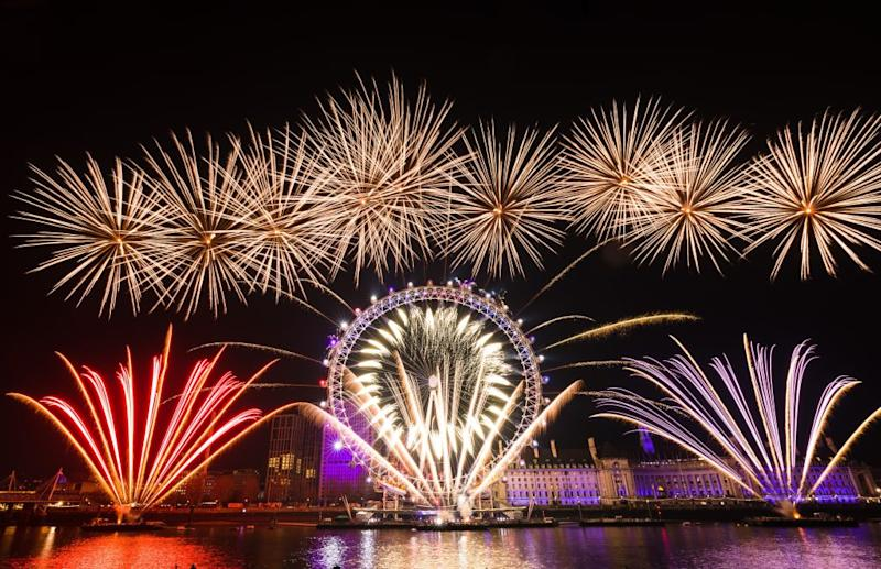 Fireworks light up the sky above the London Eye during the new year celebrations in London, United Kingdom on Jan. 1, 2020. | Vickie Flores—Anadolu Agency/Getty Images